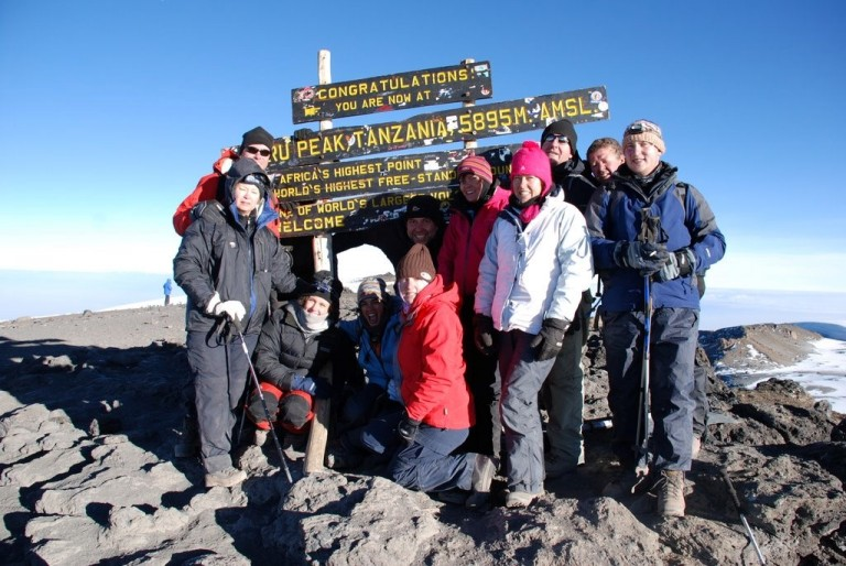The team on top of Mt Kilimanjaro, 5895m