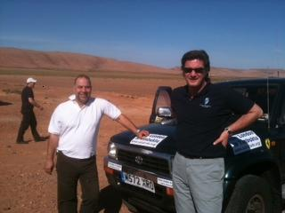 Gus (left) with his car in the Sahara