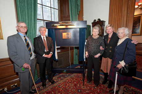 Dr Alfred Wild is joined at the Universits of Edinburgh's Old College by senior Uiversity figures and members of his family to unveil the Patrick Wild Centre plaque